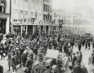 The CFA (Cape Field Artillery) marches along Adderley Street in Cape Town, upon their return from German South West Africa, 1915. They are en route to the City Hall, where the Mayor is preparing to congratulate them on their success in bringing the former German colony under British control. (Photo by Paul Thompson/FPG/Getty Images)
